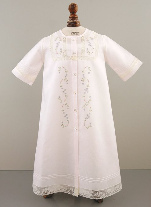 Light pink Christening gown with five pearlescent buttons down the front, lovely embroidery, and lace inserts, long sleeves, and pin tucks  around the bottom of the gown.